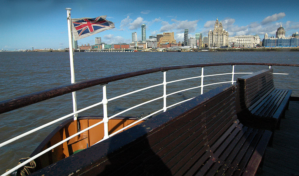 Mersey Ferry aproaches the Liverpool Waterfront with flag at high mast!-flickr-jimmedia